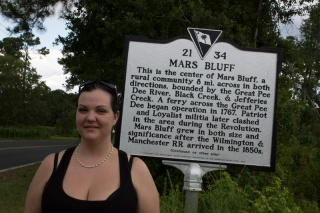 Faith Creech (director) is standing in the middle of Mars Bluff.