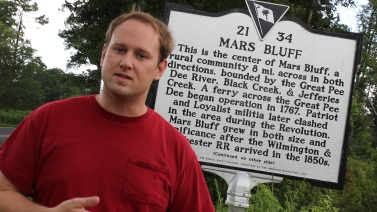 Michael Tolbert (actor/producer/director) of documentary series standing in the middle of Mars Bluff.